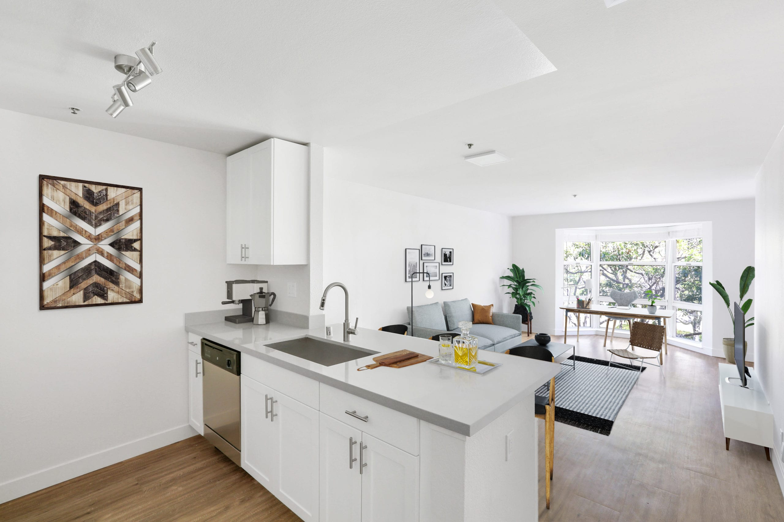 kitchen opening out to living room in bayside village open floorplan